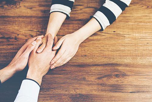 Hands being held in comfort