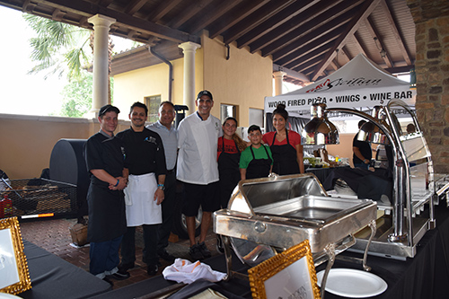 Group photo of chefs and employees