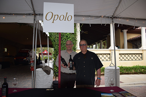 Two employees in front Opolo wine stand