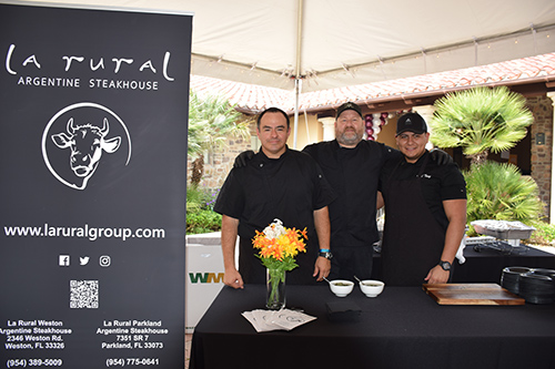 Three chefs behind the La Rural Argentine Steakhouse stand