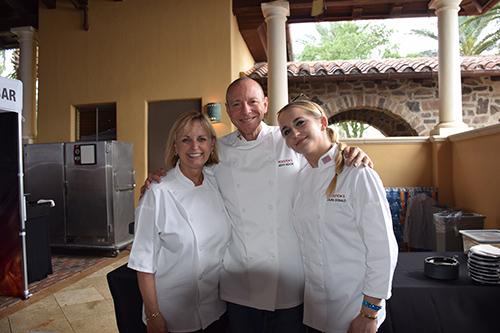 Three chefs embracing