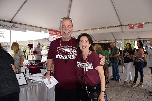 Couple with MSD t-shirts at the One Beat CPR + AED 2nd annual We Are Stoneman Douglas event