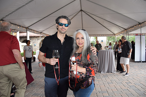 Couple enjoying wine at the One Beat CPR + AED 2nd annual We Are Stoneman Douglas event