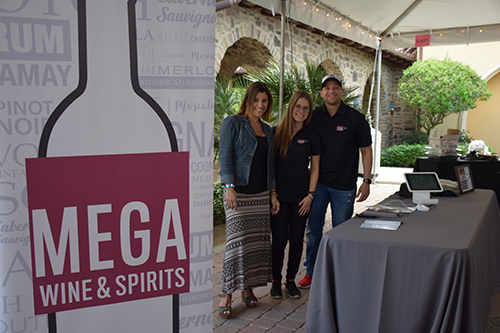 Employees at Mega Wine & Spirits stand