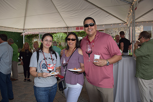 Family enjoying food and wine at the One Beat CPR + AED 2nd annual We Are Stoneman Douglas event