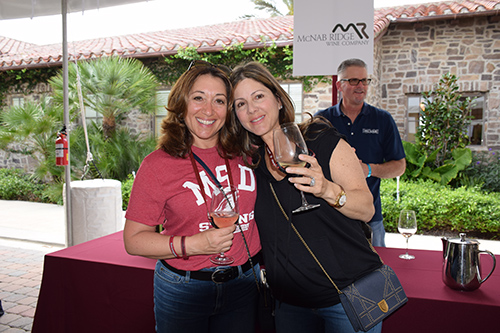 Two ladies enjoying wine at the One Beat CPR + AED 2nd annual We Are Stoneman Douglas event