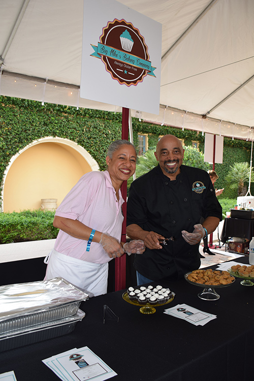 Two chefs smiling behind Big Mike's Baking Company stand