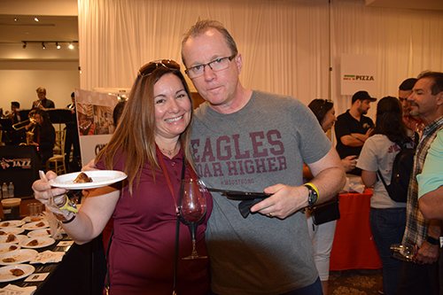 Couple enjoying food at the One Beat CPR + AED 2nd annual We Are Stoneman Douglas event