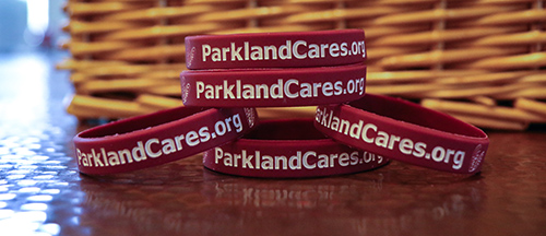 Table of Parkland Cares bracelets stacked