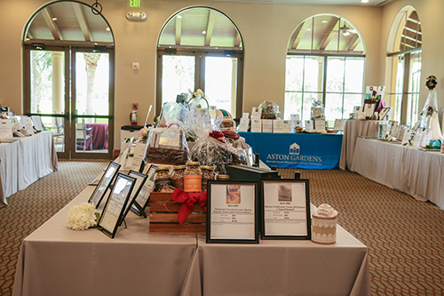 Tables filled with items for auction