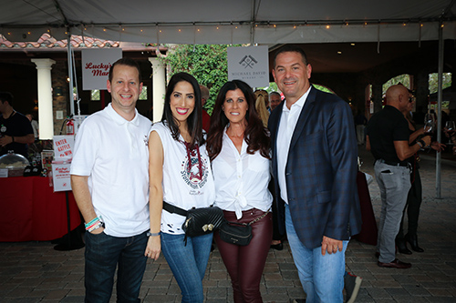 Two couples smiling at the One Beat CPR + AED 2nd annual We Are Stoneman Douglas event