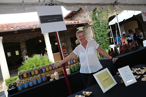 Woman behind the of Laurie's Pantry granola stand