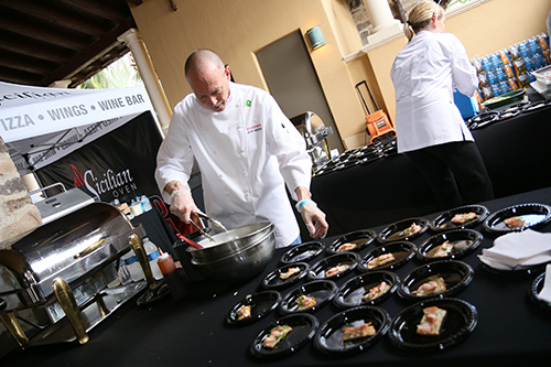 Chef preparing food for the One Beat CPR + AED 2nd annual We Are Stoneman Douglas event