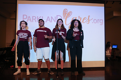 4 students singing at the Parkland Cares ceremony