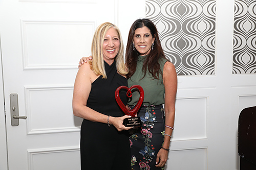 Debi Weisman with Heart Plaque