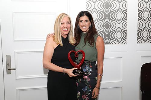 Debi Weisman with Heart Plaque