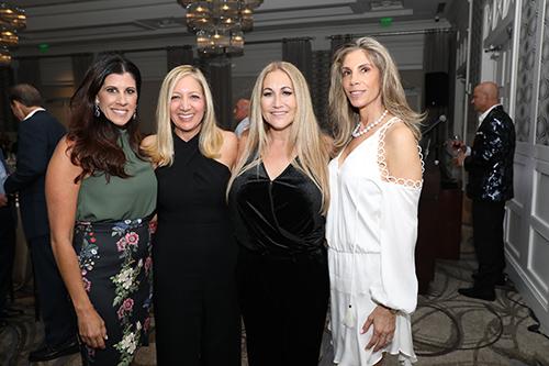 Four smiling ladies