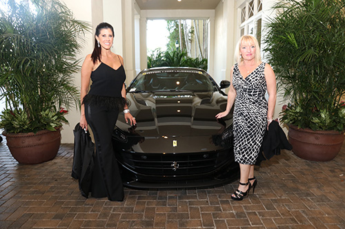 Stacey and April posing nextto a Ferrari