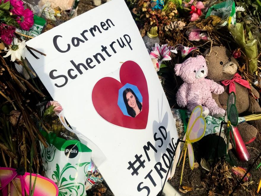 A makeshift shrine for Carmen Schentrup stands outside Marjory Stoneman Douglas High School.